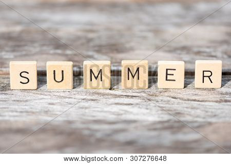 Summer Wood Letters On A Woodden Table In Sunlight