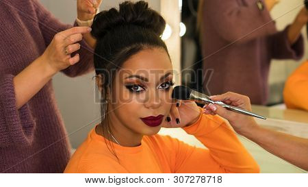 Portrait Stylish African American. Girl Posing In Beauty Salon With High Hairstyle And Make-up Party