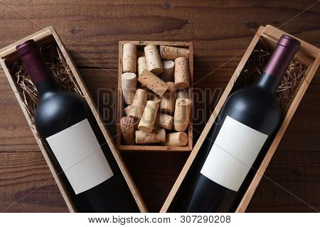 Wine Still Life: Two wood wine boxes with a bottle with blank labels. Between the boxes is a small box full of old corks.