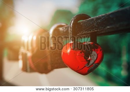 Many Love Padlocks Locked On Iron Railing On A Blurred Background. Tourists Place. Love Sign And Rom