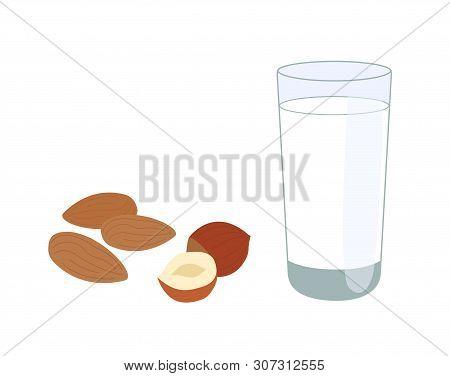 Glass Of Nutty Vegetarian Milk, Alongside Almonds And Hazelnuts