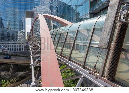 La Defense, Paris - April 14, 2019 : Kupka Chrome And Glass Pedestrian Bridge Exterior View In La De