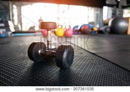 Dumbbell Weight Training Equipment With Blurry Background, Healthy Life And Gym Exercise Equipments