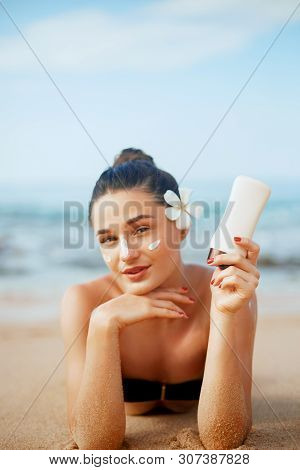 Suntan Lotion Woman Applying Sunscreen Solar Cream. Beautiful Happy Cute Woman  Applying Suntan Crea