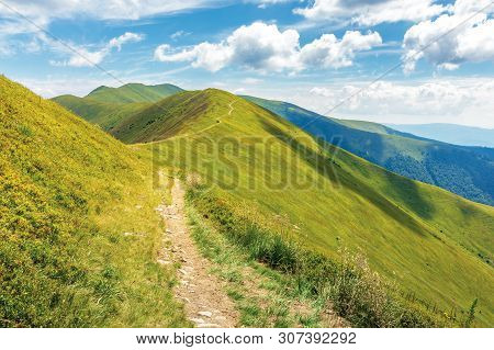 Traverse Path Through Mountain Range. Beautiful Summer Landscape At High Noon. Green Grassy Alpine H