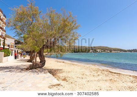 Mallorca, Spain - May 6, 2019: Coastal Promenade With Sandy Beach In Port De Pollenca (puerto Pollen