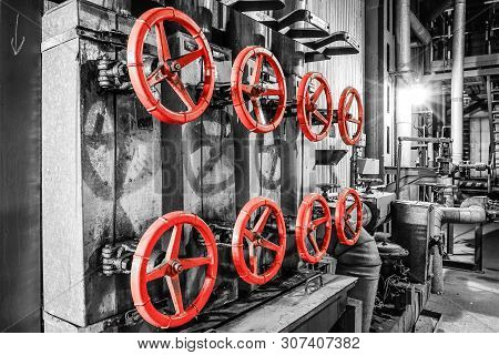 Red Valves In Heating Plant In Black And White Style