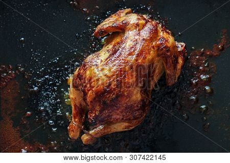 Unhealthy Fatty Foods. Chicken Baked In The Oven Floats In Fat. Cholesterol, Carcinogens, And Unheal