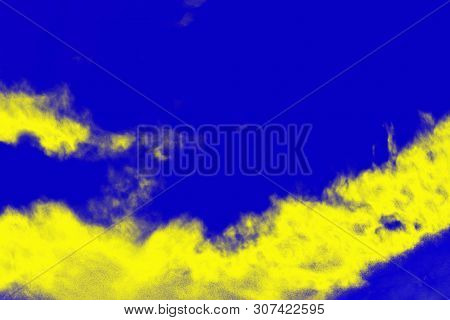 Abstract Paint Splash Background. Yellow Lemon Color On The Ultramarine Blue Background
