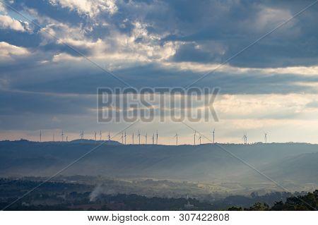 Wind turbines. Wind power generators. Alternative energy, reduce global warming. Reduce insufficient energy problems. poster