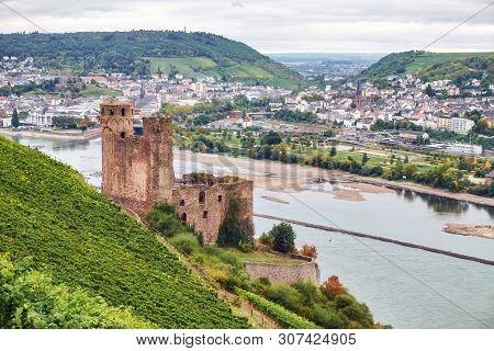 View From A Tourist Route On Hessen Land To The Ruine Burg Ehrenfels On The River Rhine With Bingen