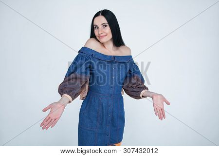 Unaware Doubtful Woman Spreads Hands, Raises Eyebrows With Hesitation, Dressed In Stylish Outfit, Fe