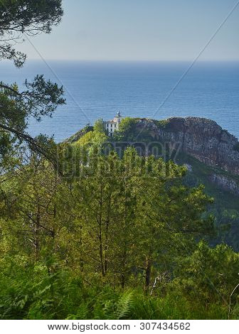 Monte Ulia Mount With The Faro De La Plata (lighthouse) And The Cantabrian Sea In Background. Pasaia