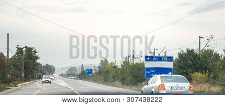 Jucu, Romania - Sep 26, 2013: View From The Car At The Romanian Highway Street Road Sign Featuring A
