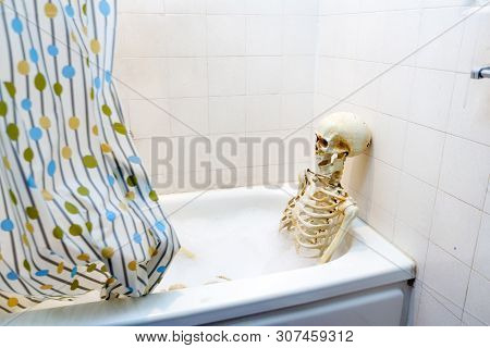 Bony Skeleton Taking A Bubble Bath In A Grungy Off-white Dirty Tub