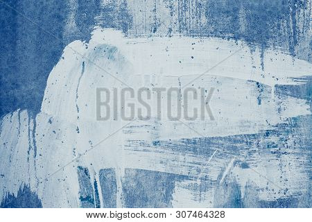 Smeared White Paint Stains On The Blue Wall. Drips Of White Paint On The Blue Canvas. Abstract Patte