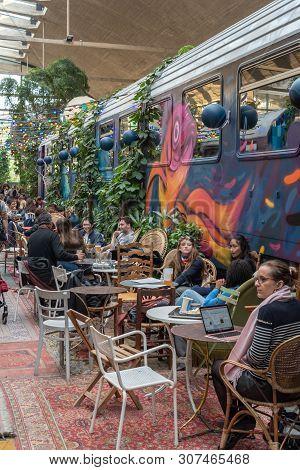 Paris, France - April 15, 2019 : People Near A Decorated Train Car In La Felicita Italian Bar-restau