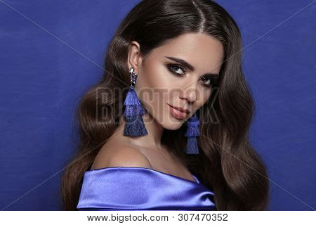 Beautiful Brunette With Tassel Earrings Over Blue. Jewelry Bijouterie Fashion. Sensual Woman With Sh