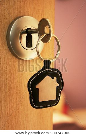 A Key In A Lock With House Icon On It