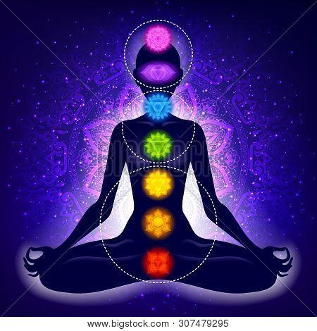 Meditating Woman In Lotus Pose. Yoga Illustration. Colorful 7 Chakras And Aura Glow. Mandala Backgro