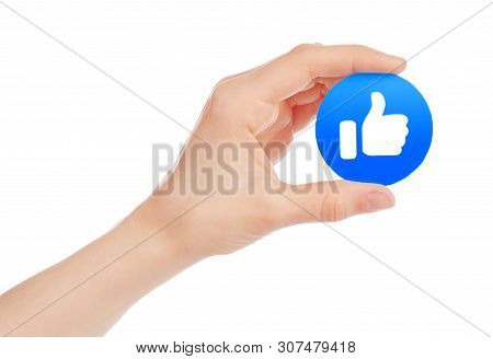 Kiev, Ukraine - May 15, 2019: Hand Holds New Facebook Like Empathetic Emoji Reaction, Printed On Pap