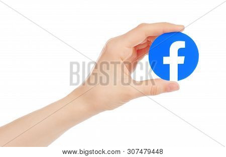 Kiev, Ukraine - May 15, 2019: Hand Holds New Facebook Logo Printed On Paper. Facebook Is A Well-know