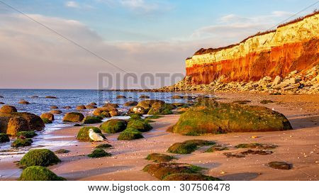 Red Cliffs Of Old Hunstanton Beach At Sunset