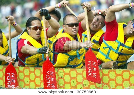 FLUSHING, NY - AUGUST 10:  Members of the Dragonflies dragon boat team compete on Meadow Lake at Flushing Meadow Corona Park August 10, 2004 in the Flushing neighborhood of New York City.