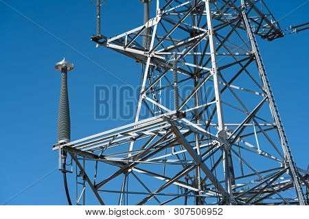 High Voltage Power Line Tower Sky Closeup