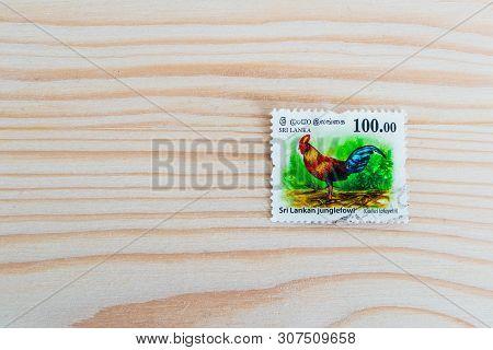 Sri Lanka, Kandy - 18 May 2019: Postage Stamp Sri Lanka, Decorated With Junglefowl Asian Rooster, Wo