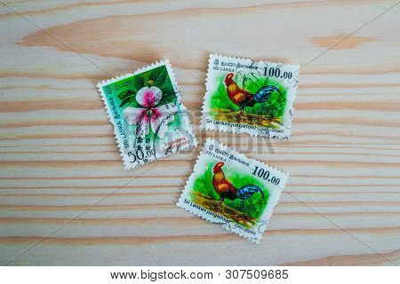 Sri Lanka, Kandy - 18 May 2019: Postage Stamps Sri Lanka, Decorated With Junglefowl Asian Rooster An