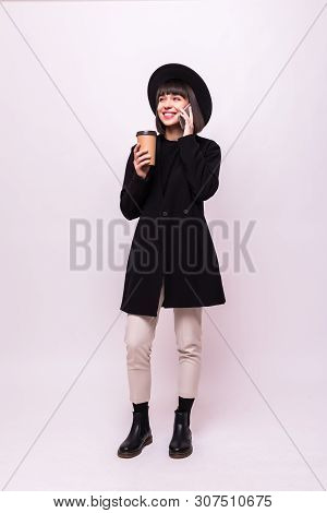Full Length Portrait Of A Young Pretty Girl In Black Hat And Hipster Clothes Talking On The Phone Ho