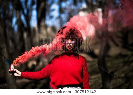 Beautiful Woman In Red Smoke Grenade Standing In The Street