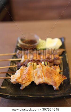 Japanese Cuisine Grilled, Teriyaki Skewers Yakitori On A Plate