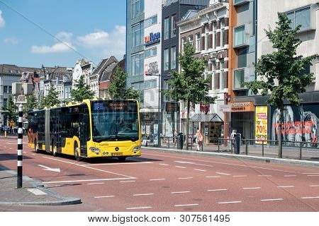 Utrecht, The Netherlands - July 05, 2018: Cityscape Dutch City Utrecht With Urban Bus Waiting For Cr