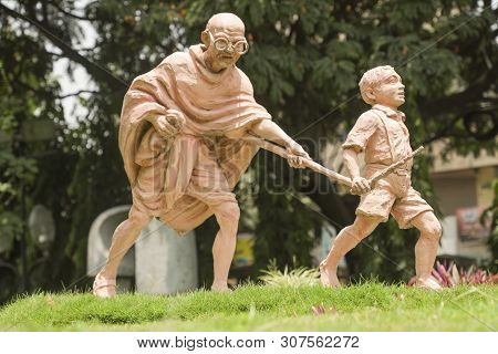 Bangalore, India, June 4, 2019 : Sculpture Of Mahatma Gandhi And Child, Child Moving By Holding The