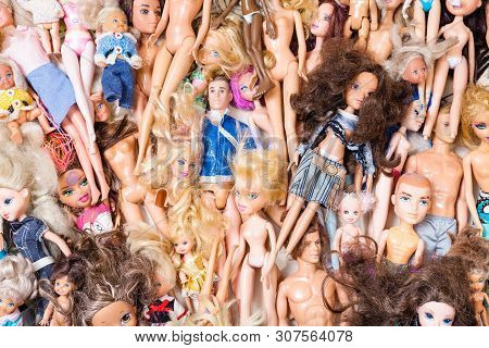 Moscow, Russia - June 17, 2019: Top View Of Various Old Used Fashion Dolls ( Barbie, Ken, Shelly, Ch