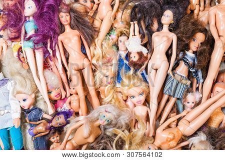 Moscow, Russia - June 17, 2019: Top View Of Heap Of Various Old Used Fashion Dolls ( Barbie, Ken, Sh