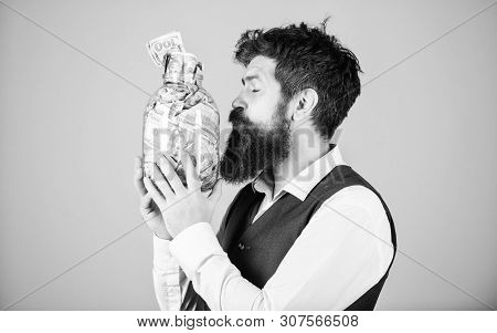 poster of Attractive investment. Bearded man investor kissing glass jar with investment money. Successful businessman making a good investment. His investment producing income