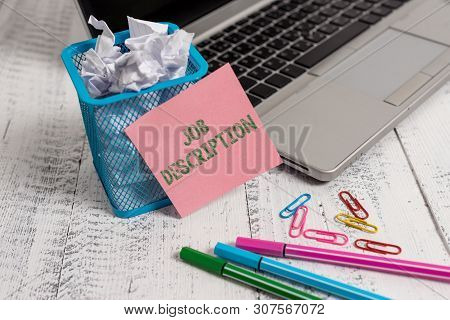 Writing note showing Job Description. Business photo showcasing a formal account of an employee s is responsibilities Laptop sticky note waste basket crushed paper clips pens vintage table. poster