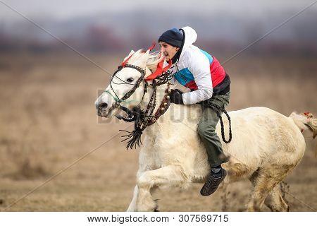 Pietrosani, Romania - January 6, 2019: Man Is Bareback Riding An Adorned Horse Before An Epiphany Ce