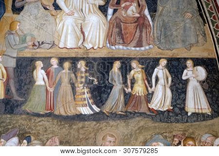 FLORENCE, ITALY - JANUARY 10, 2019: Detail of the Active and Triumphant Church fresco by Andrea Di Bonaiuto, Spanish Chapel in Santa Maria Novella Principal Dominican church in Florence, Italy