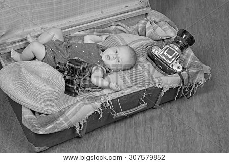Progressive Baby. Family. Child Care. Small Girl In Suitcase. Traveling And Adventure. Portrait Of H