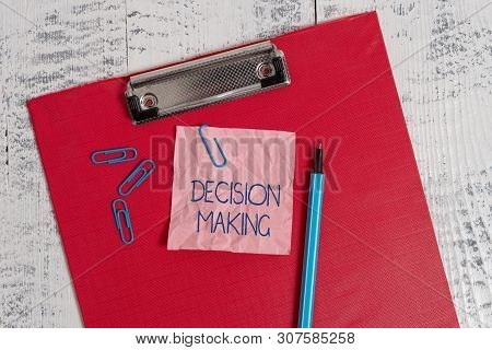 Writing note showing Decision Making. Business photo showcasing The act of deciding between two or more possibilities Colored clipboard crushed sticky note clip marker old wooden background. poster