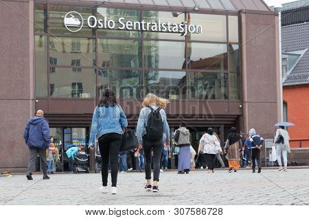 Oslo, Norway - June 20, 2019: People Outside The Oslo Central Station Entrance.