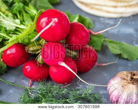 A Bunch Of Fresh Red Radishes On A Gray Background Shot From Close Range