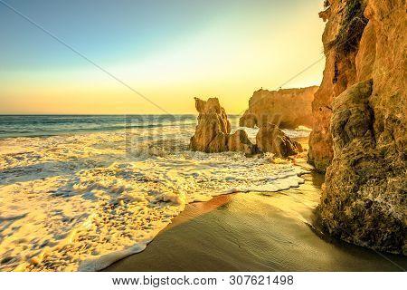 Sunset Sea Background In California West Coast Wallpaper. El Matador Beach At Beautiful Sunset Light