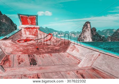 Wooden Boat On Sailing Travel In Ratchaprapa Dam And Cheow Larn Lake, Khao Sok Nature Beautiful In T