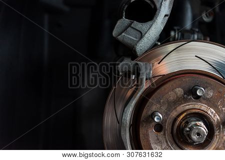 Disc Brake And Asbestos Brake Pads At Car Garage