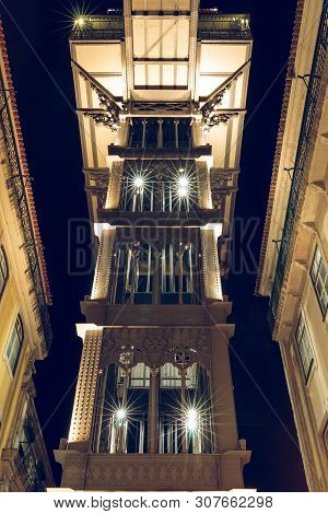 Rear View Of Elevator Elevador De Santa Justa In Lisbon At Night Time. Portuguals Capital With The H